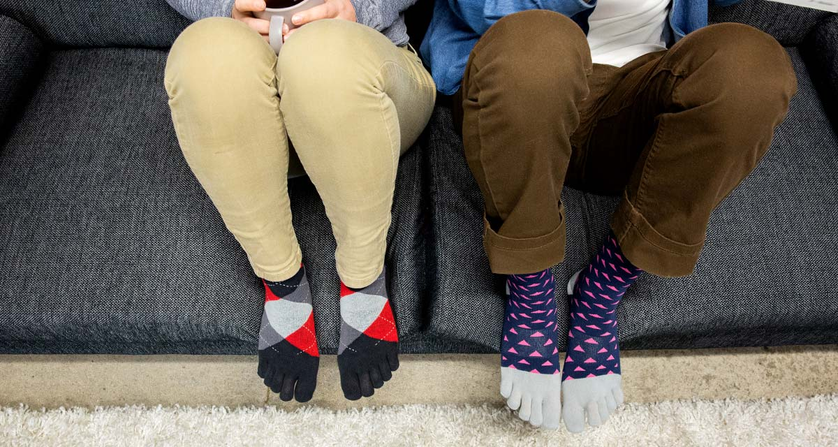 Two people wearing Injinji Everyday Lightweight Crew Socks