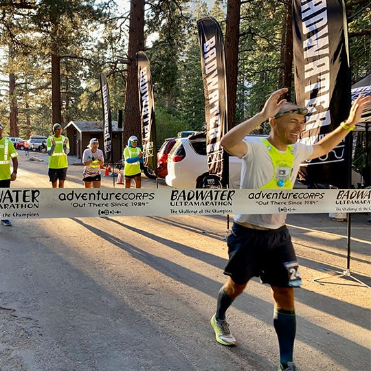 Jonathan Gunderson crossing the finish line at 2021 Badwater 135
