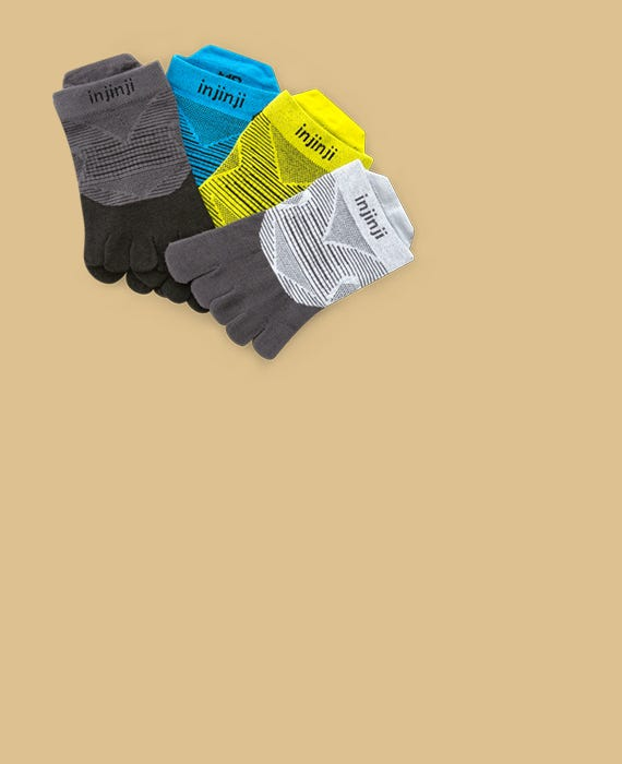 Four pairs of socks laying flat